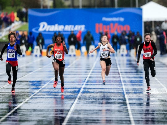 Kerris Roberts of Waterloo East, second from left, wins the girls 100 meter dash at the Drake Relays Friday, April 28, 2017.