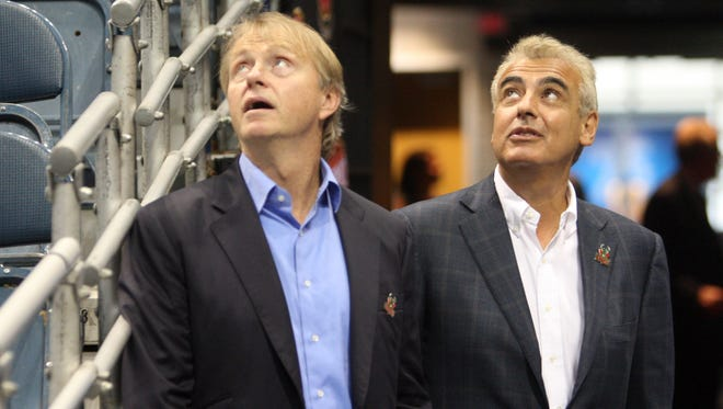 Milwaukee Bucks co-owners Wesley Edens (left) and Marc Lasry check out the jumbotron featuring new coach Jason Kidd at the BMO Harris Bradley Center in July.