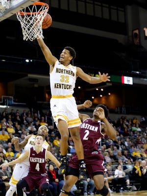 Northern Kentucky Norse guard Dantez Walton (32) makes a dunk over Eastern Kentucky in the 2nd half at BB&T Arena Sunday December 10, 2017.