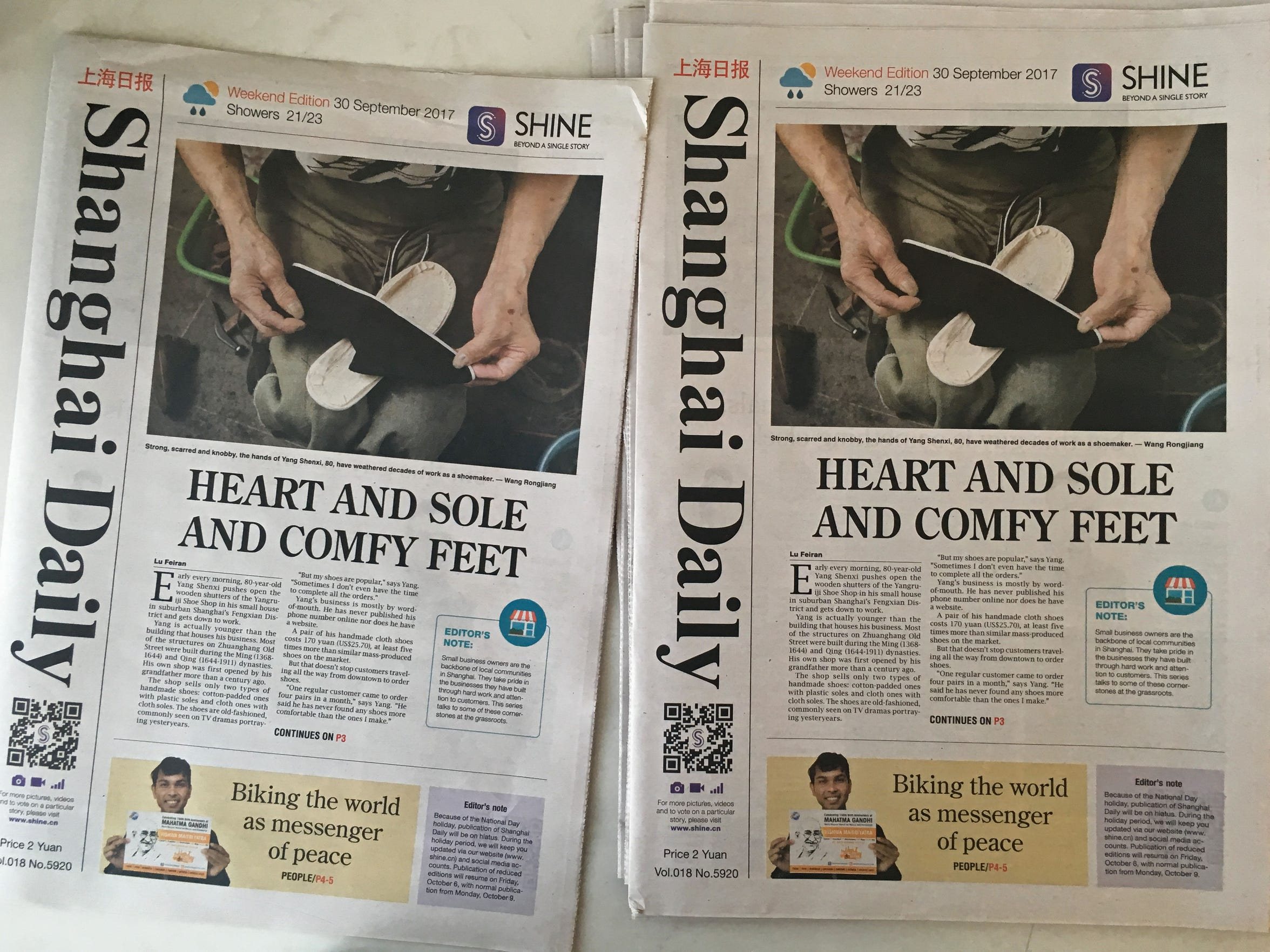 Copies of the Shanghai Daily set out on a table in the Daily's newsroom on Sunday, Sept. 30, 2017, in Shanghai, China.