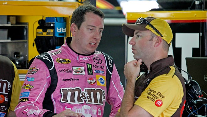 Kyle Busch in the garage at Charlotte Motor Speedway during practice for the Bank of America.