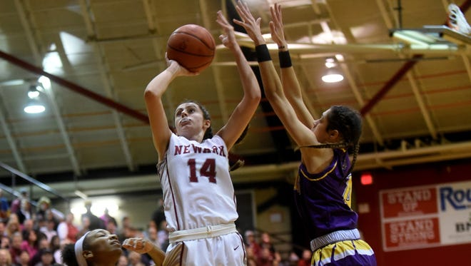 Newark sophomore Katie Shumate takes a shot March 7 during a Division I regional semifinal against Reynoldsburg. The Wildcats beat the Raiders 72-40.