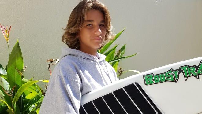 Sam Ruskin, 13, of Jupiter, helped rescue a man whose boat sank in Jupiter Inlet Friday.
