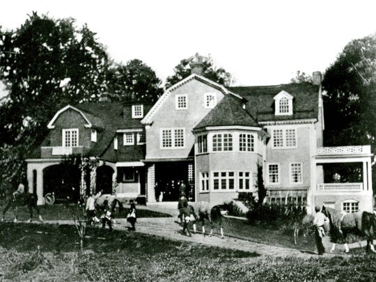 The Sun Briar Court clubhouse, formerly Washington Whitney home, built about 1830.