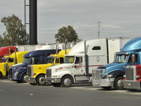 Trucks parked at Love's Travel Stops and Country Stores.