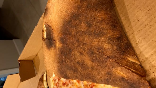 Is this pizza burnt? Titusville needs to know.