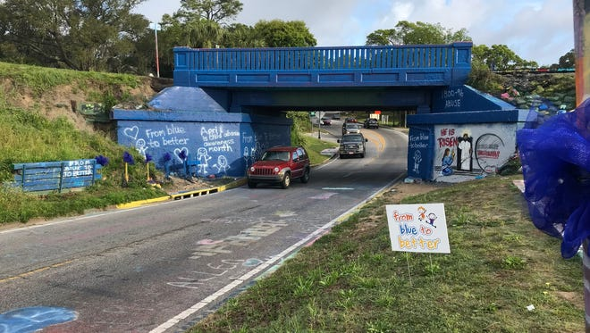 "The Graffiti Bridge goes ""blue"" for the ""From Blue to Better"" campaign to fight child abuse."