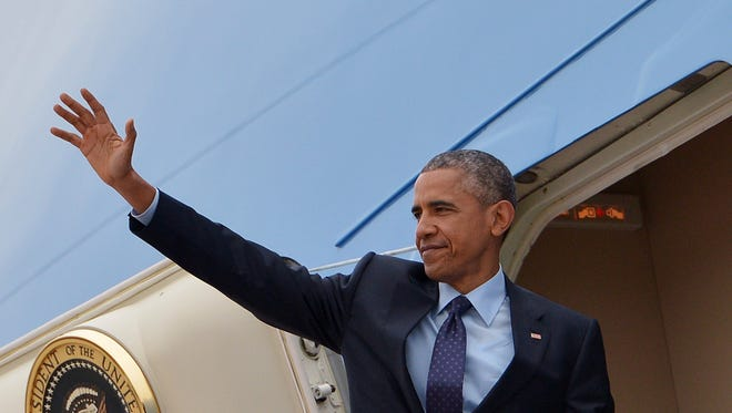 President Obama waves from Air Force One before departing from Andrews Air Force Base in Maryland Wednesday. Obama is heading for a visit to Jamaica and Panama.