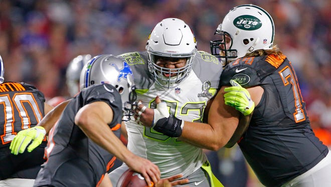 Team Carter defensive end Calais Campbell of the Arizona Cardinals (93) goes after Team Irvin quarterback Matthew Stafford in the first half of the Pro Bowl, which was played at University of Phoenix Stadium. Team Irvin won the game 32-38 behind Stafford's 316 passing yards.