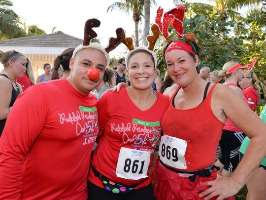 TC Running's John Jacobo,  June Montgomery and Kathy Neu