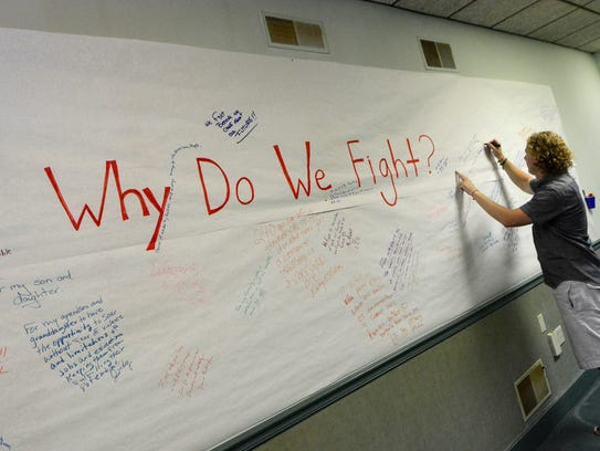"""State representative Kevin Schreiber signs a """"Why do"""