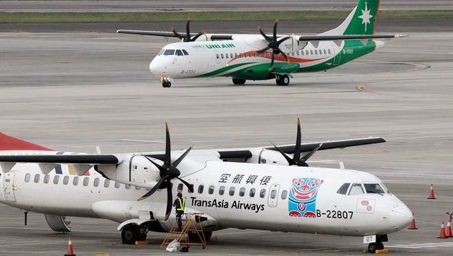 This file photo from Feb. 7, 2015, shows TransAsia Airways turboprops at the Songshan Airport in Taipei, Taiwan.