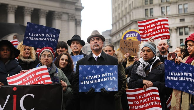 Muslims and immigration activists participate in a prayer service and rally, Friday, in New York City.