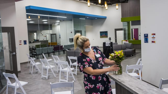 OSF HealthCare marketing and communications event planner Hillary Donnelly prepares flowers to be placed around the the new Center for Health in the former Cub Foods in Midtown Plaza on Knoxville Avenue in Peoria Tuesday, August 11, 2020. The preparations were for public tours of the complex and a blessing of the building.DAVID ZALAZNIK/JOURNAL STAR