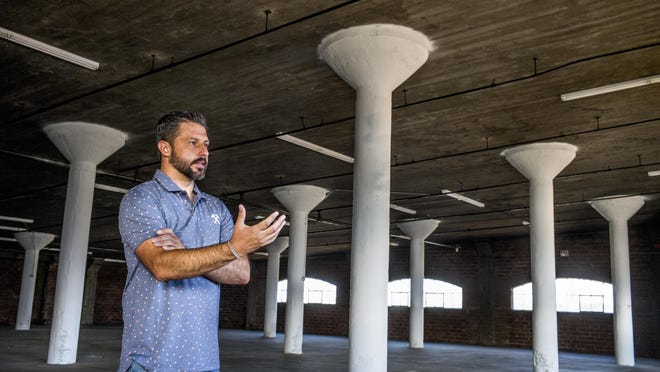 Standing on the seventh floor of the former Federal Warehouse building at 800 SW Adams St. in Peoria on Tuesday, developer Casey Baldovin describes his plans for renovation of the building into residential and commercial space.