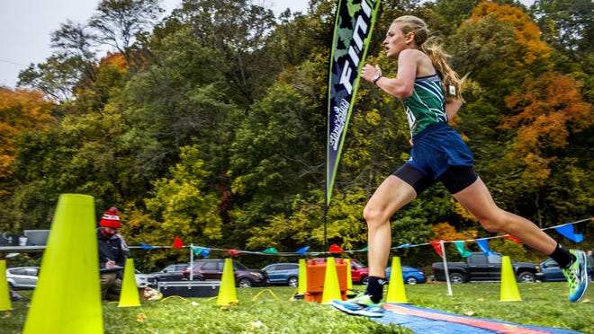 Notre Dame High School's Maria Stedwill crosses the line finishing in third place in the Big 12 Conference cross country championships Saturday, October 17, 2020 at Detweiller Park in Peoria.