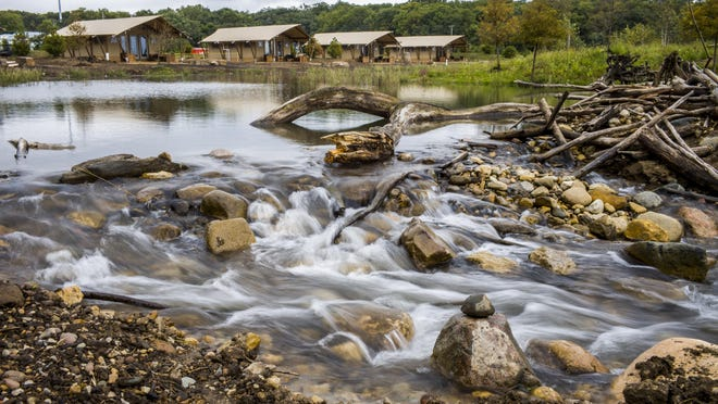 Water flows in the trout stream with several of the tent cabins in the background at Sankoty Lakes Resort and Retreat in Spring Bay Monday, September 28, 2020.
