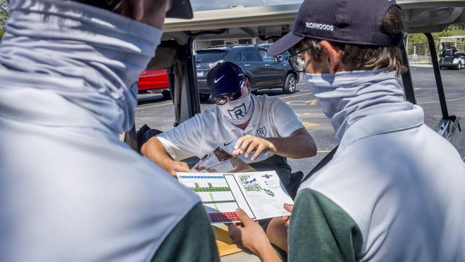Richwoods High School head golf coach Patrick Hogan distributes scorecards to his players before the IVC Invitational golf tournament at Arrowhead Country Club near Edlestein Thursday, September 3, 2020.