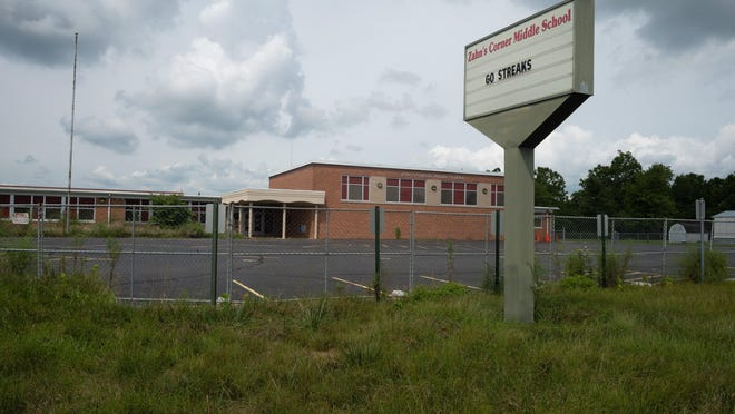 A fence surrounds Zahn's Corner Middle School on Aug. 12 in Piketon. The school closed in May 2019 after traces of americium, a byproduct of the gaseous diffusion process of uranium enrichment, was detected by a U.S. Department of Energy detector near the school. The school is about two miles from the site of the former Portsmouth Gaseous Diffusion Plant.