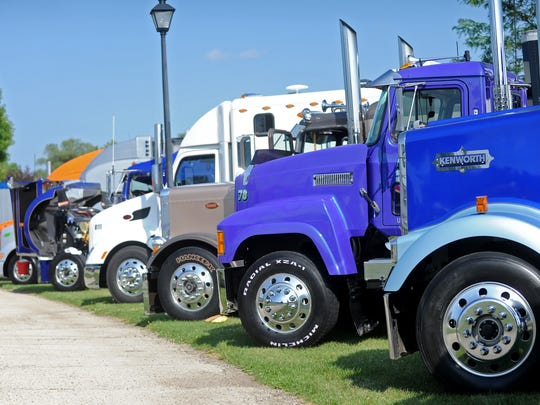 Trucks line up for show at the 25th Annual Waupun Truck-n-Show. Truckers from around the country gather to show off their rigs in a salute to the trucking industry.