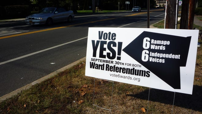 Signs in support of a ward system in Ramapo were seen  in the town prior to the Sept. 30, 2014, vote on referendums that would establish a ward system and expand the town board.