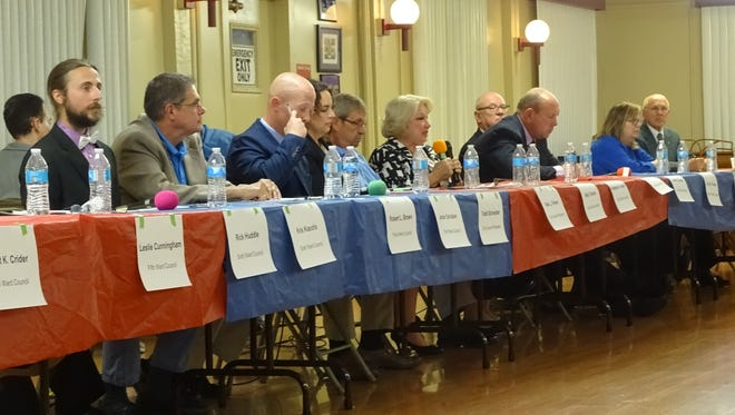 Fourteen local candidates in contested elections showed up Thursday to the candidates' debate night held by the League of Women Voters every year.