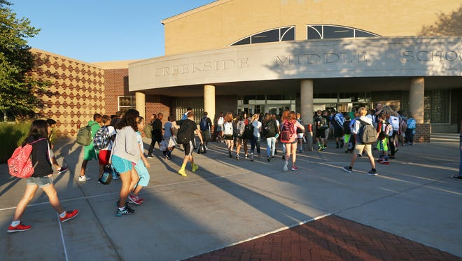 Creekside Middle School students headed to classes on the first day of school, Aug. 13, 2014, as Carmel Clay Schools began the 2014-15 school year.