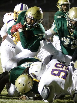 Bralen Trahan scores a touchdown for Acadiana giving the rams a 6-0 lead against Alexandria in the first round of the playoff Friday night at Bill Dotson Stadium.
