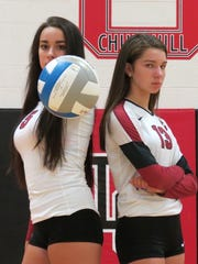 The Dunn sisters excel for Churchill's volleyball team.