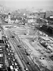 The Chrysler Freeway, shown looking east in 1964, extended I-75 north along what used to be Hastings Street.