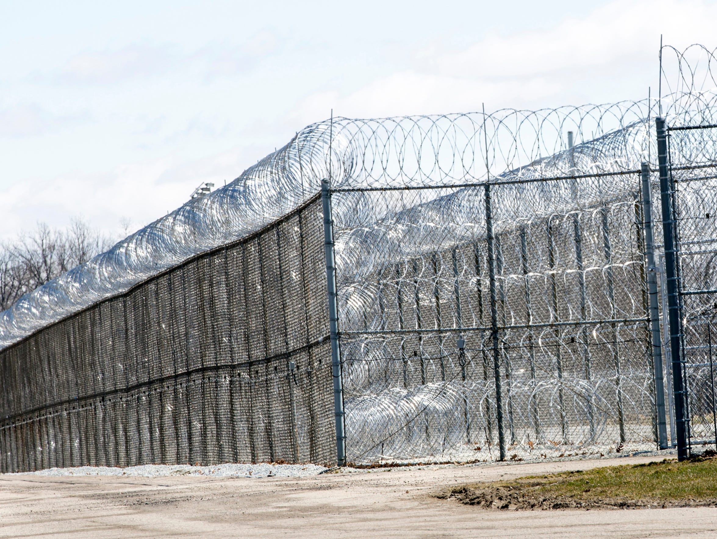 The perimeter  of Lapeer's Thumb Correctional Facility, where corrections officer Ashley Benedict worked. She alleges in a federal lawsuit she was first sexually harassed, then retaliated against.