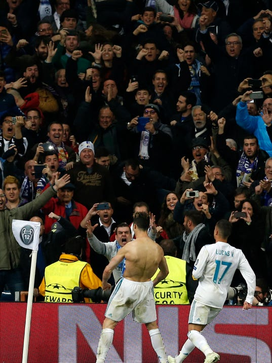 Real Madrid's Cristiano Ronaldo celebrates after scoring during a Champions League quarter final second leg soccer match between Real Madrid and Juventus at the Santiago Bernabeu stadium in Madrid, Wednesday, April 11, 2018. (AP Photo/Francisco Seco)