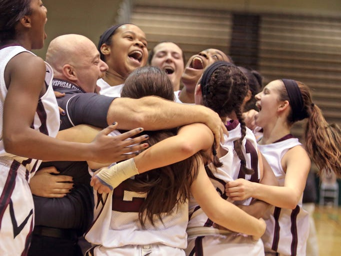 Ossining celebrates after defeating Cicero-North Syracuse 74-59 to win the New York State Girls Basketball Championship Class AA championship game at Hudson Valley Community College in Troy March 15, 2014.