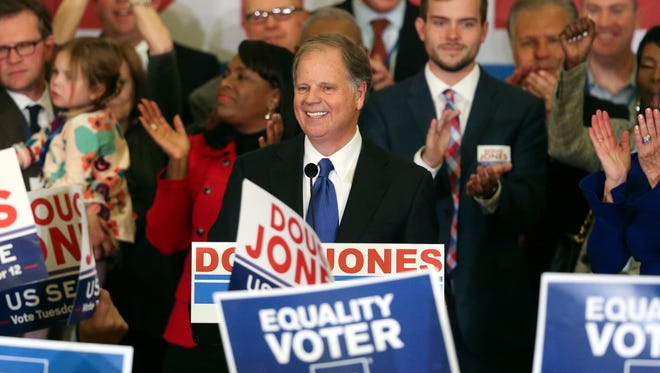 Democrat Doug Jones speaks Tuesday, Dec. 12, 2017, in Birmingham, Ala. In a stunning victory aided by scandal, Jones won Alabama's special Senate election, beating back history, an embattled Republican opponent and President Donald Trump, who urgently endorsed GOP rebel Roy Moore despite a litany of sexual misconduct allegations.