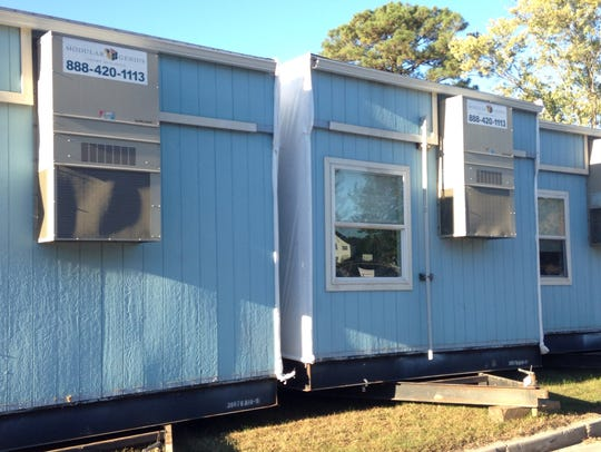 This Oct. 21 photo shows blue portable structures that
