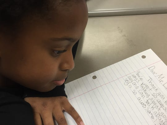 Mt. Juliet Elementary fifth-grader Ava Bryant writes a thank you note to Thad Livingston, who has donated money and equipment to the school after mistakenly being included on an email list.