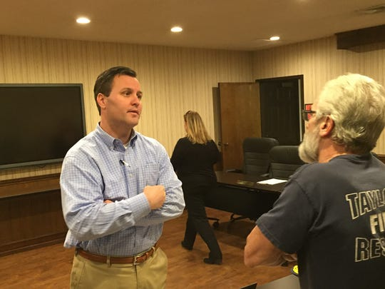 State Rep. Dan Hamilton, left, speaks with Taylors Fire and Sewer District commissioner Doug Wavle, right, on Tuesday evening.