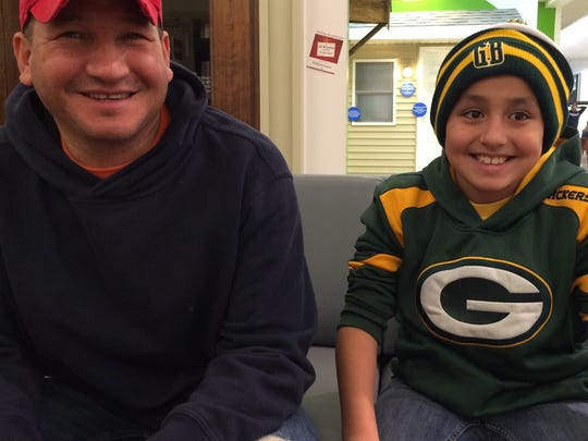 Arturo and son Andres Lopez shopped in the Fox River Mall during gametime Thursday night.