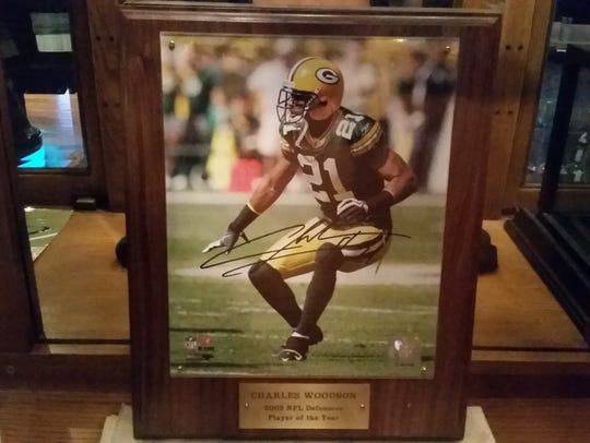 The 2009 NFL defensive player of the year plaque given
