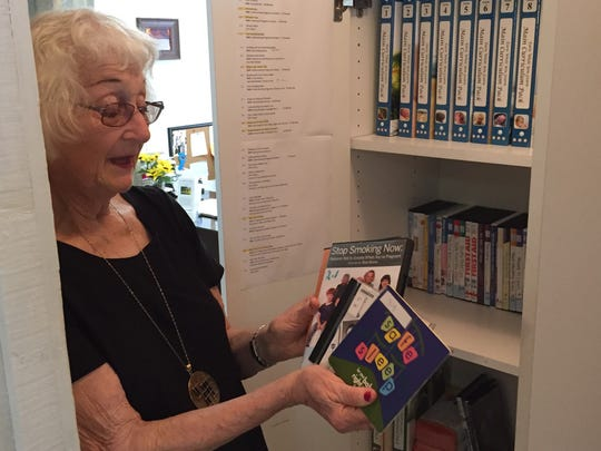 """Volunteer Roberta """"Bert"""" Williamson-Musco shows courses available to clients"""