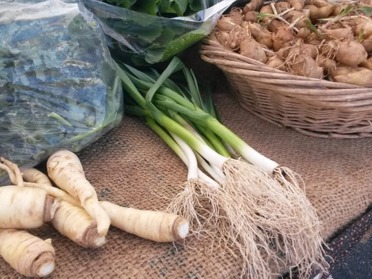Parsnips, green onions and sunchokes from Long Valley Eco-Biotic Farm at West Asheville Tailgate Market.