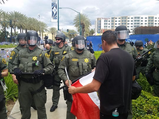 Police began marching on protesters outside the Anaheim Convention Center on March 25, 2015, after the demonstration spilled into the street.