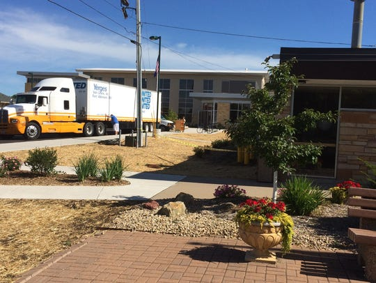 Workers, volunteers move books, furniture into new