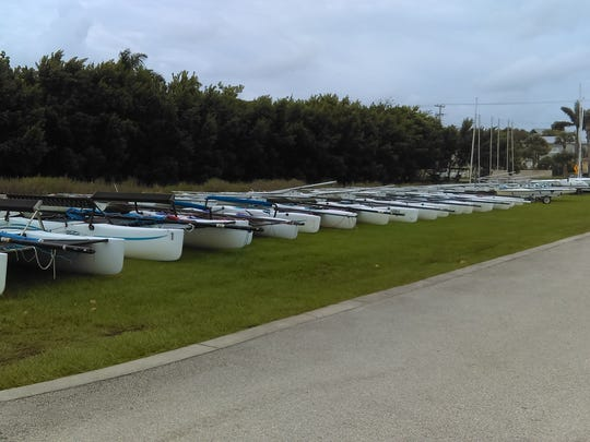 Several dozen watercraft owned by Martin County high schools' sailing teams are lined up near the U.S. Sailing Center at Indian Riverside Park in Jensen Beach.