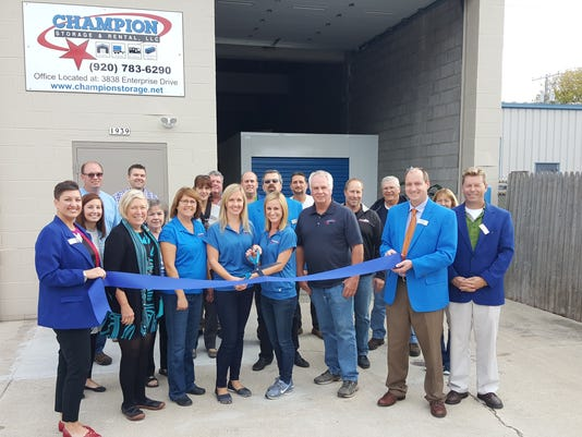 Champion Storage ribbon cutting