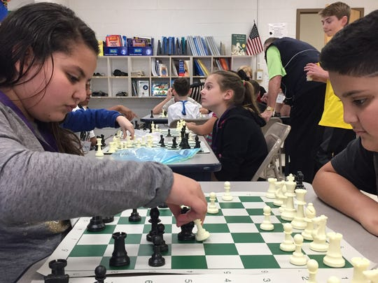 Samantha Attas, left, and Lehi Sorcia, right, play chess  after school as part of the Mt. Juliet Elementary chess club.