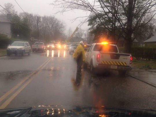 Crews work on downed power lines at East Main and Second