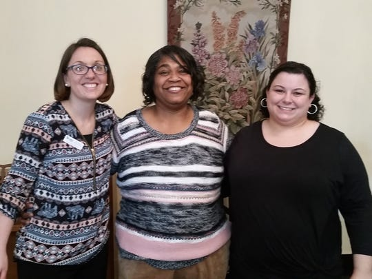 From left to right are Britney Smith, Habitat, executive director; Beverly Lattimore, who is getting a new home via Habitat; and Michelle Wells, media relations and procurement officer for the housing agency.