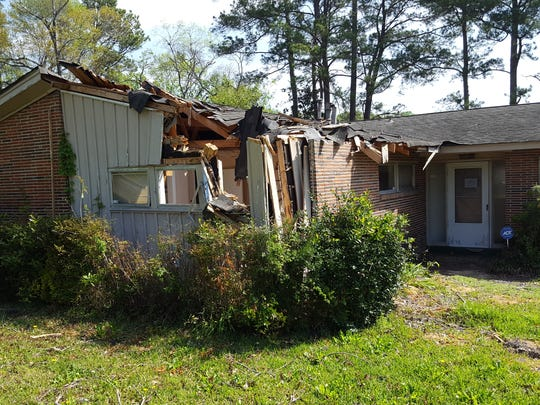 A blighted house deemed to be an unsafe structure by the city on Edgar D. Nixon Avenue.