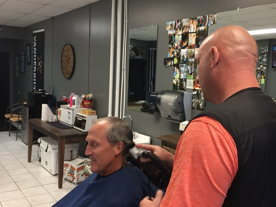 NEXT quality haircuts owner Mike Foust gives a haircut